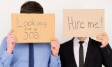 Unemployed Office Workers Holding Cardboard Signs Job Hunting